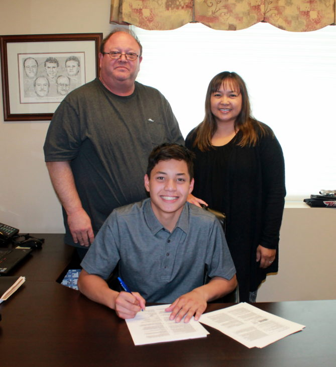 May 22 Robertson Signs with Parents Hugh and Mercedes