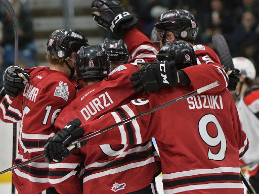 Sean Durzi and Nick Suzuki celebrate a goal with their new Guelph Storm teammates in this OHL file photo after a trade deadline move had the former Owen Sound veterans sent down Hwy. 6 to the Attack's Midwest Division rival. Photo by Terry Wilson / OHL Images.