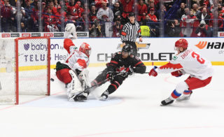 OSTRAVA, CZECH REPUBLIC - JANUARY 5: Canada's Akil Thomas #16 shoots on Russia's Amir Miftahkov #1 as he falling down during gold medal game action at the 2020 IIHF World Junior Championship at Ostravar Arena on January 5, 2020 in Ostrava, Czech Republic. (Photo by Matt Zambonin/HHOF-IIHF Images)