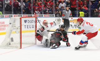 OSTRAVA, CZECH REPUBLIC - JANUARY 5: Canada's Akil Thomas #16 score the game winner on Russia's Amir Miftahkov #1 as he falling down during gold medal game action at the 2020 IIHF World Junior Championship at Ostravar Arena on January 5, 2020 in Ostrava, Czech Republic. (Photo by Matt Zambonin/HHOF-IIHF Images)