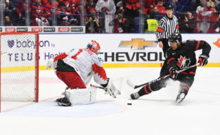 OSTRAVA, CZECH REPUBLIC - JANUARY 5: Canada's Akil Thomas #16 falls as he breaks in on Russia's Amir Miftahkov #1 during gold medal game action at the 2020 IIHF World Junior Championship at Ostravar Arena on January 5, 2020 in Ostrava, Czech Republic. (Photo by Matt Zambonin/HHOF-IIHF Images)