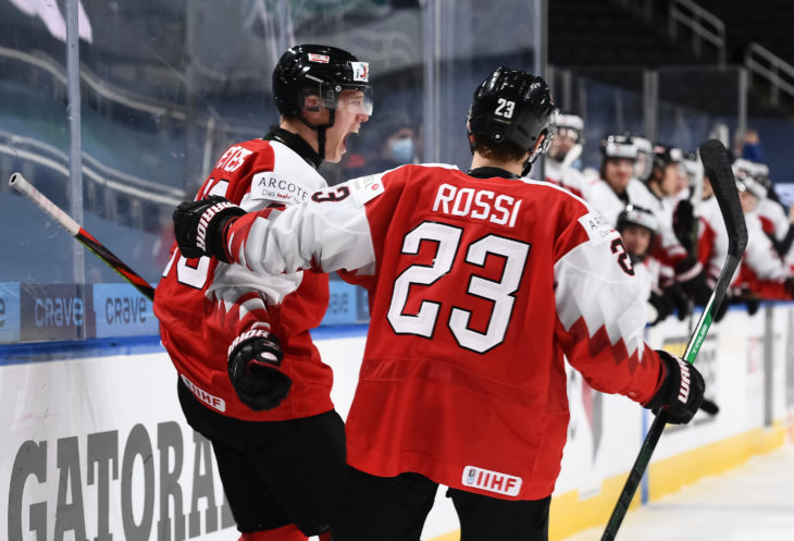 EDMONTON, AB CANADA - DECEMBER 29: Austria's Senna Peeters #22 celebrates with Marco Rossi #23 after scoring a second period goal against Russia during preliminary round action at the 2021 IIHF World Junior Championship at Rogers Place on December 29, 2020 in Edmonton, AB Canada. (Photo by Andrea Cardin/HHOF-IIHF Images)