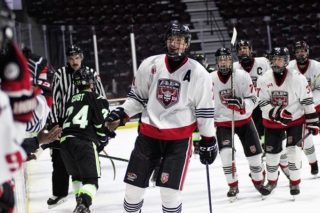 Ryder McIntyre celebrates after scoring for the Ajax-Pickering Raiders