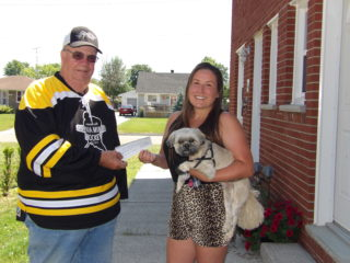 FSMH President Fred Sterling hands a cheque for $6,315.00 Randi Rogers the winner of the online 50/50